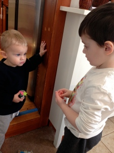 """Zai gives his """"birthday cake"""" to Camden made out of combined play dough colors and a pipe cleaner."""