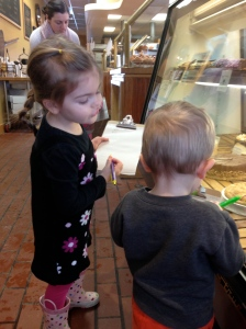 Lily and Zai carefully observing bakery goodies. Lily looks so grown up with clipboard in hand.